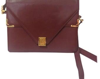 90's vintage Cartier double flap envelope shoulder bag with gold-tone logo charm closure and frames. Classic purse from Must de Cartier