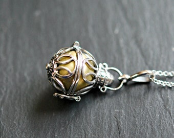 Harmony ball necklace, sterling silver bola pendant, brass ball, musical chime, bola charm, pregnancy, baby necklace - catcher in the rye