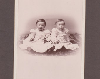 Cabinet Card of Twin Babies Holding Flowers