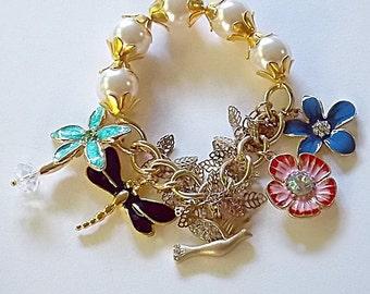 Enamel charm bracelet. Enamel flowers - Dragonfly - Gold bird - Gold leaves - Faux pearls
