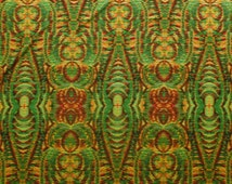 Mirrored Kaleidoscope Tribal Green and Red Single Stretch Jersey Fashion Fabric - sold by the metre
