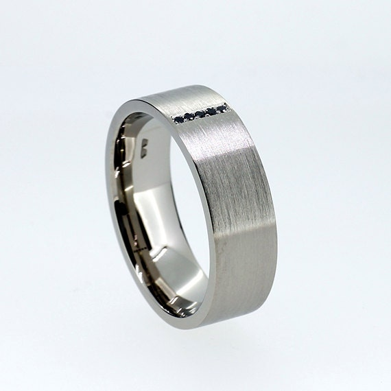 Wide black diamond wedding ring made from white gold modern