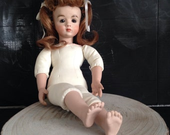 Ceramic doll with red hair