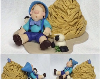 Fimo Figurine Boy on Haystack