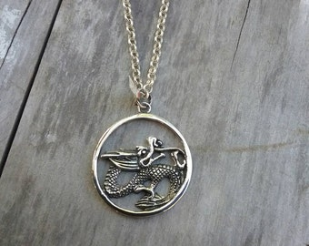 mythical dragon pendant . sterling silver.