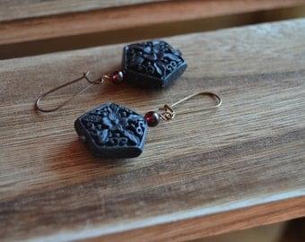 Geometric cinnabar dangle earrings with garnet.