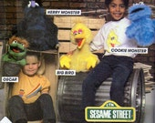 McCall's 8527 - Sesame Street Hand Puppets Pattern - Oscar Hand Puppet, Big Bird hand Puppet, Cookie Monster and Herry Monster Hand Puppets