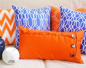 Orange Oblong cushion cover / throw pillow case featuring rustic button and loop closure, Hand sewn ruffles