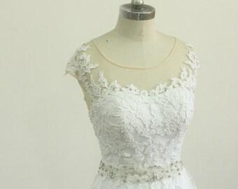 Keyhole back white A line lace wedding dress with elegant beading sash