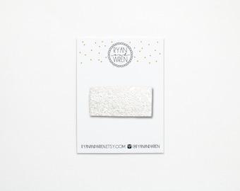 White glitter snap clip