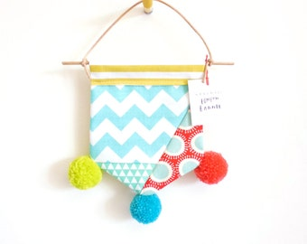 A Little Pompom Wall Banner Hanging