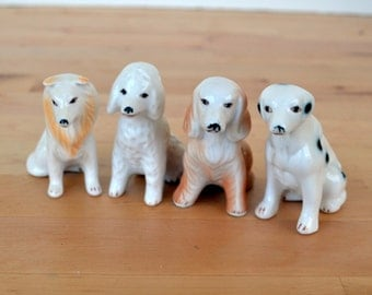 Set of 4 ceramic dog statues, dalmation, setter, poodle, retreiver