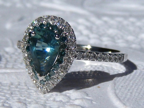 Teal Sapphire and Blue Diamonds in White Gold Diamond Halo