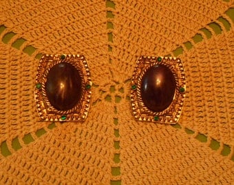 Clip Earrings with a Large Purple Center Stone and Green Rhinestones. (250)