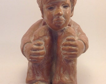 vintage sculpture Robert Cole l971 clay look young boy sitting chin on knees wearing sneakers