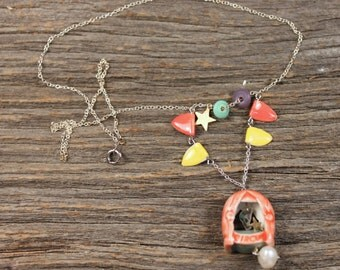 Ceramic circus tent beads with plastic flying trapeze girl with star necklace