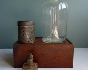 A vintage French glass stoppered bottle