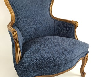 Vintage bergere chair reupholstered in blue cheetah chenille