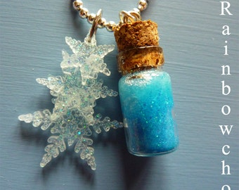 Flask of snow crystals and its flakes in resin