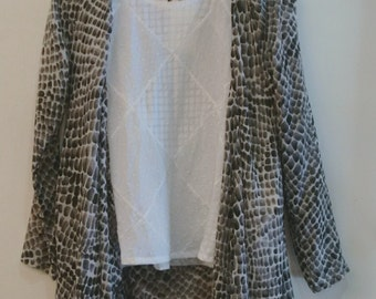 Monochrome versatile layering vest in a soft cotton voile/gauze print ( white top used for layering)
