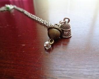 Peter Pan thimble and acorn necklace