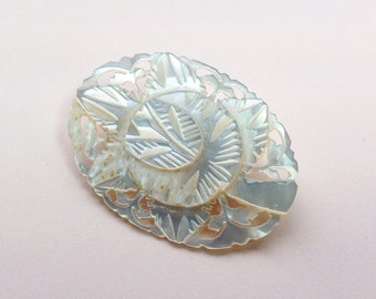 Vintage carved mother of pearl brooch.