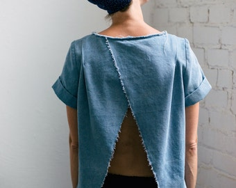 Open back top in light blue denim with raw edges