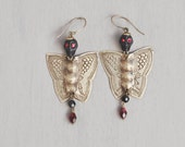 Death Moth Earrings - vintage brass butterfly wings with black skull and vintage glass - gothic mourning jewelry