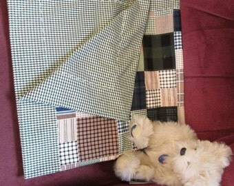 Soft flannel plaid self binding receiving blanket with two matching burp cloths