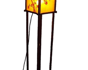 A floor lamp is in stained-glass window style