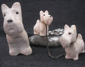 chalkware dog and puppies