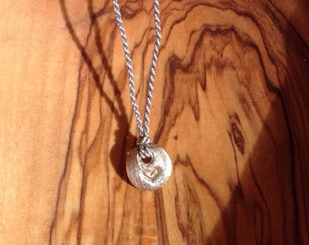 Tiny Fine Silver pendant on Silk String