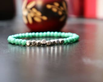 Silver color and turquoise beaded bracelet