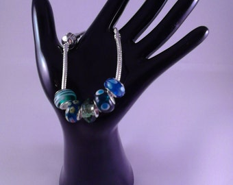 Green and blue glass/silver charms on a 19cm bracelet