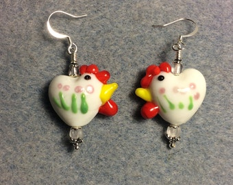 White with pink and green spots heart shaped lampwork hen bead earrings adorned with clear Czech glass beads.