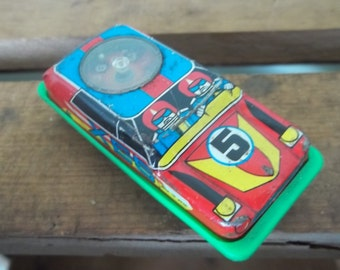 Vintage Japanese Plastic and Tin Friction Toy Car