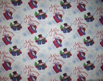 snowman fabric that says Merry Christmas and has silver glitters  by Patti Reed from 2008 for Fabric Traditions
