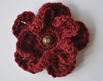 Crocheted red magnolia flower corsage