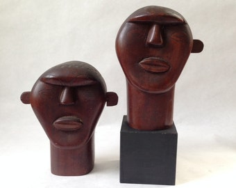 pair folk art carved heads, tribal and modern