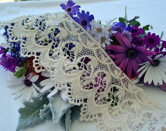 CR016. a beautiful cream wide embroided cotton lace. straight edge at the top and a scalloped lower edge.
