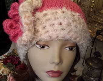 Winter hat with flower crochet and made by petronella