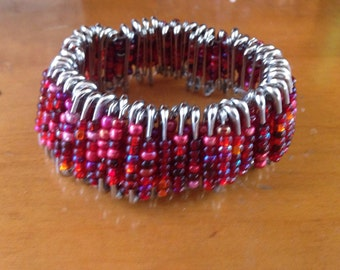 Safety pin bracelet in reds
