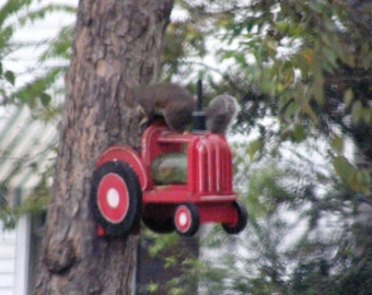 Handmade wooden squirrel Feeder designed to look like a tractor