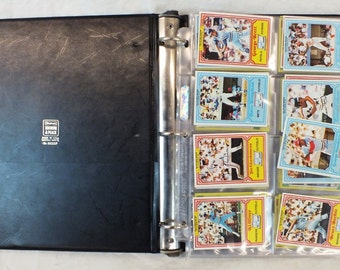 Collection of 1980's baseball cards in album. About 50 cards total.