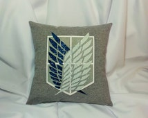 Attack on Titan cotton t-shirt made into a decorative pillow cover. Anime bedding with the Survey Corp symbol from Shingeki no Kyojin.