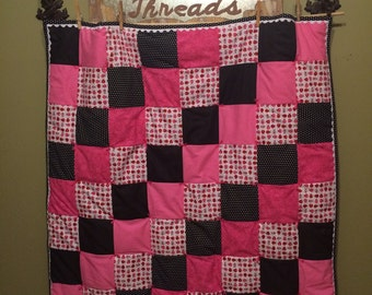 Pink, white and black ladybug quilt!