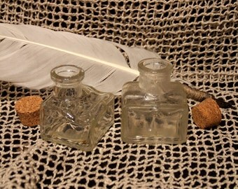 Antique inkwells with corks. Glass. Vintage.