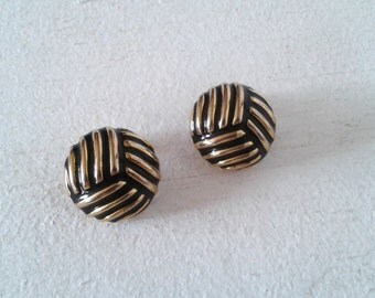 Golden and black clip earrings