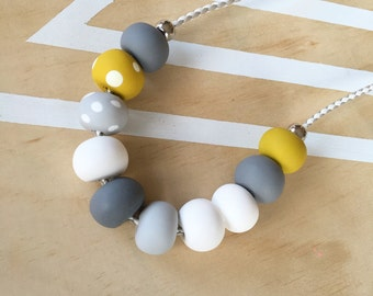 Polymer clay bead necklace. White, grey, mustard, spot beads! 'The mia'