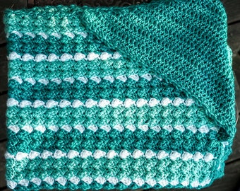 Green and white striped hooded baby blanket.